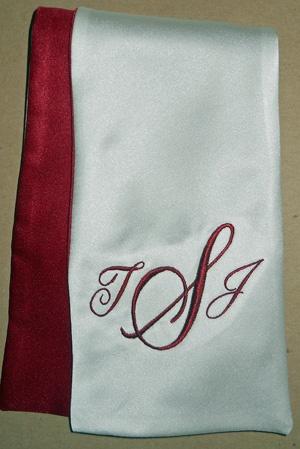 Cursive monogram in wine red.