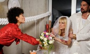 Guest Fighting With Bride at Wedding Reception --- Image by © Ragnar Schmuck/Corbis